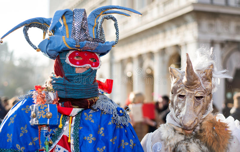 VENICE, ITALY - FEBRUARY 8, 2015: Unidentified masked couple in royalty free stock images