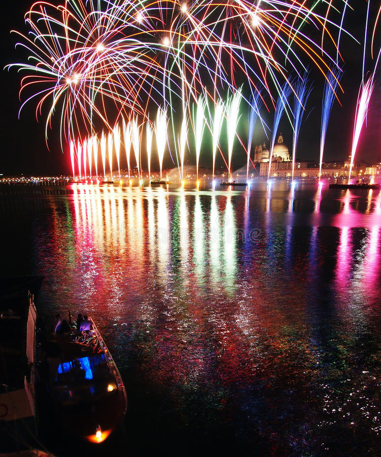 Venice, Italy - fireworks at the Festival of the Redeemer. VENICE, ITALY- JULY 16, 2016: Fireworks at the festival of the Redeemer, with the Madonna della Salute stock images