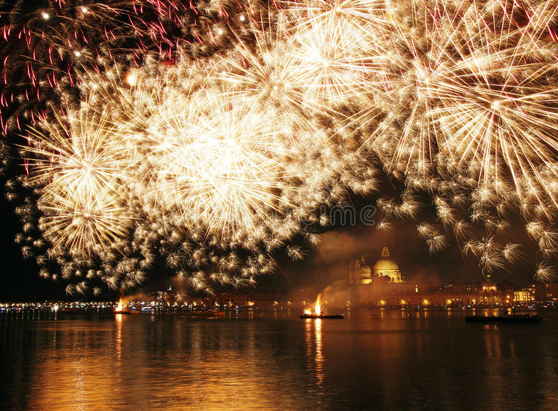 Venice, Italy - fireworks at the Festival of the Redeemer. VENICE, ITALY- JULY 16, 2016: Fireworks at the festival of the Redeemer, with the Madonna della Salute royalty free stock image