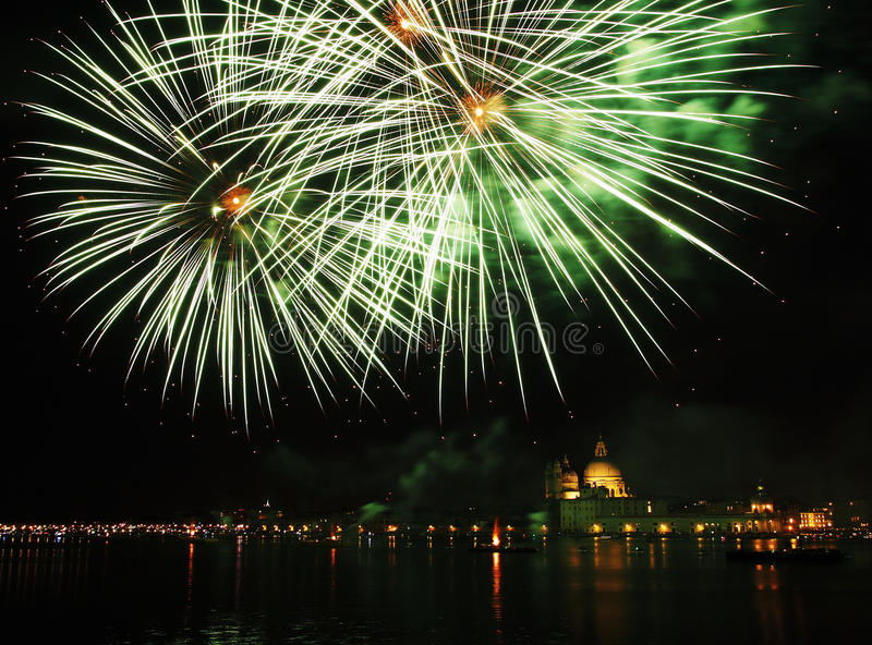 Venice, Italy - fireworks at the Festival of the Redeemer. VENICE, ITALY- JULY 16, 2016: Fireworks at the festival of the Redeemer, with the Madonna della Salute stock image