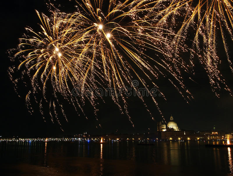 Venice, Italy - fireworks at the Festival of the Redeemer. VENICE, ITALY- JULY 16, 2016: Fireworks at the festival of the Redeemer, with the Madonna della Salute stock photography