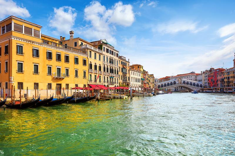 Venice, Italy. Gondolas on Grand Channel. Panorama view at Rialto Bridge. Piers royalty free stock photography