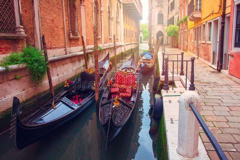 Venice, Italy. Gondolas in Venetian narrow water channel along houses royalty free stock photos