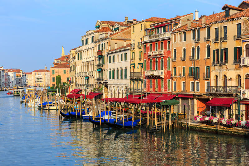 Venice, Italy. Venice Grand Canal gondolas, hotels and restaurants at sunrise from the Rialto Bridge royalty free stock images