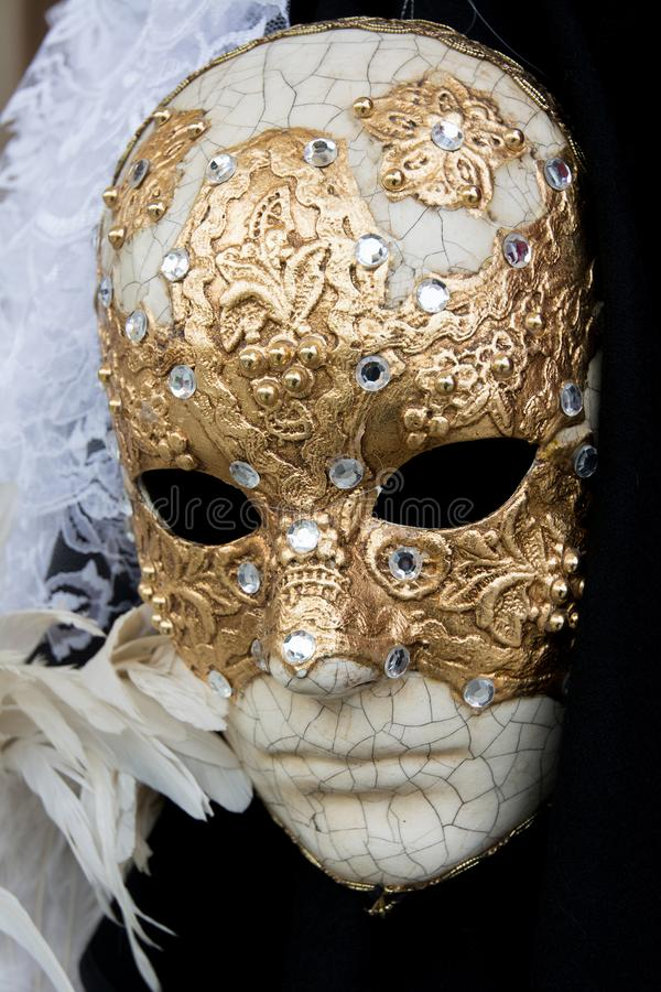 Venice, Italy - January 31, 2016: Traditional carnival masks for sale in a shop in Venice royalty free stock images