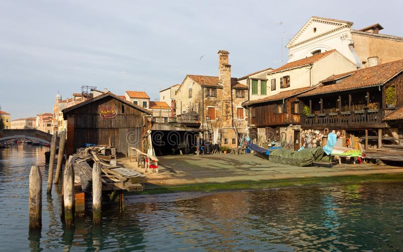 Historic San Trovaso Boatyard for Gondolas in Venice. VENICE, Italy - January 12, 2019: View of the exterior of the Squero di San Trovaso, historic boatyard royalty free stock photo