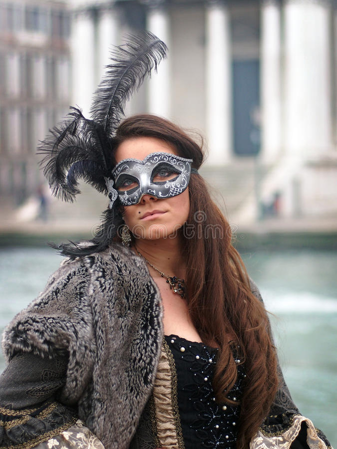 VENICE, ITALY - JANUARY 30 2016 - Woman in mask at the Venice carnival royalty free stock photo