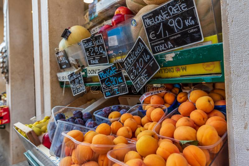 Venice, Italy - July 4, 2018: big choice of fresh fruits and vegetables on market counter stock image