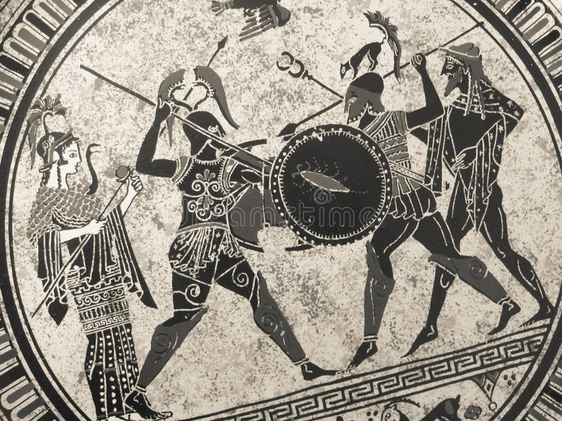 VENICE, ITALY - JULY 02, 2017: Detail from an old historical greek paint over a dish. Mythical heroes and gods fighting on it stock image