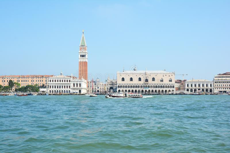 VENICE, ITALY - JULY 26, 2019:  Piazza San Marco with the Basilica of Saint Mark and the bell tower of St Mark`s Campanile royalty free stock images