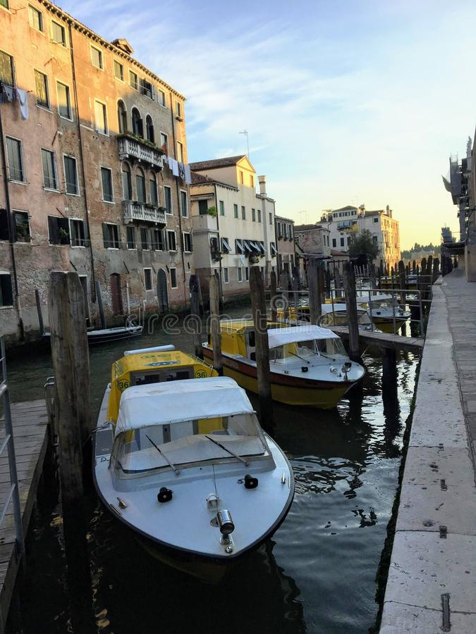 A row of Venetian water ambulance boats docked along a canal outside the hospital in Venice, Italy on a quiet summer morning. Venice, Italy - July 1st, 2019: A stock photography