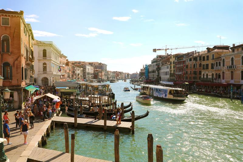VENICE, ITALY - JULY 18, 2018: tourists on gondola with gondolier in Grand Canal, Venice, Italy royalty free stock image