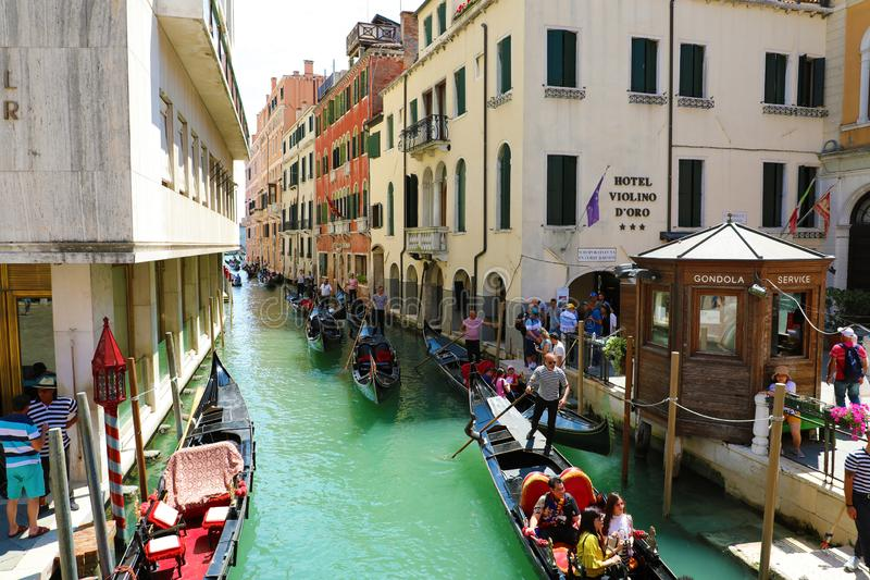 VENICE, ITALY - JULY 18, 2018: tourists on gondola in Venice channel, Italy stock image
