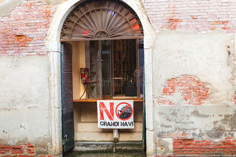 VENICE, ITALY - JUNE 15, 2017:  Banner protesting the damage caused by large cruise ships in Venice stock image