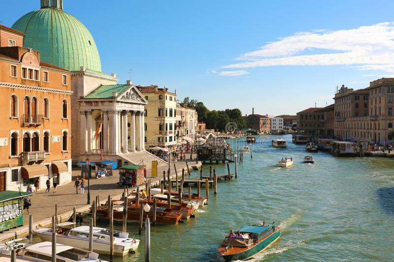 VENICE, ITALY - JUNE 18, 2018: beautiful sunset on Venice with the Grand Canal and the green dome of the church San Simeon Piccolo stock photo