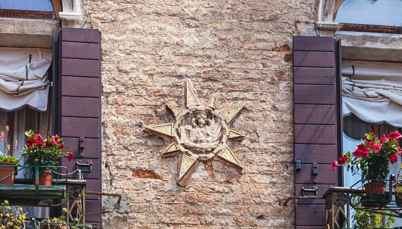VENICE, ITALY - JUNE 15, 2016 Close-up of basrelief depicting Venetian lion on building of Teatro Italia, Venice. VENICE, ITALY - JUNE 15, 2016 close-up of royalty free stock photography