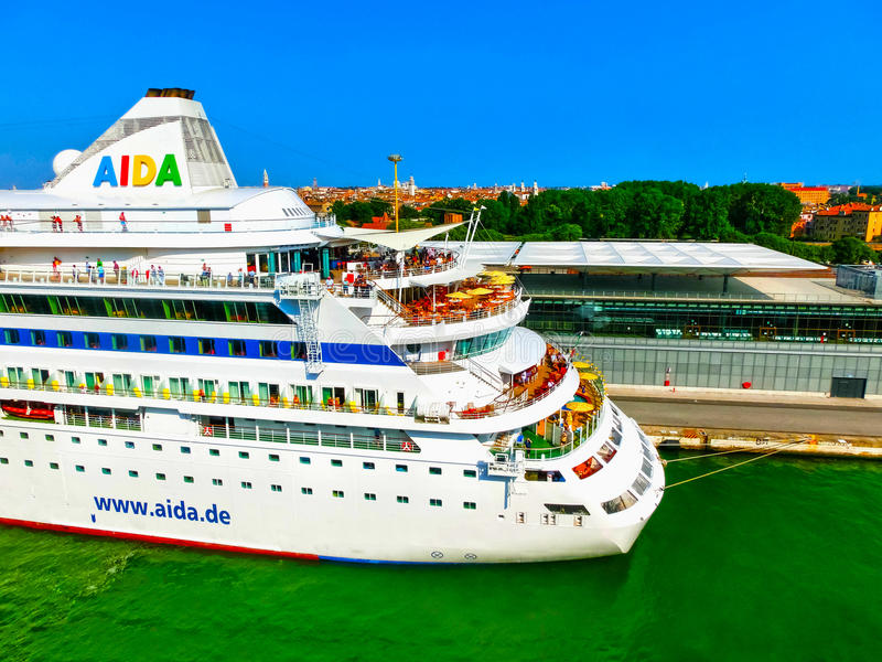 Venice, Italy - June 06, 2015: Cruise liner AIDA Vita docked at the port. Of Venice, Italy on a background of the roofs on June 06, 2015 stock photography