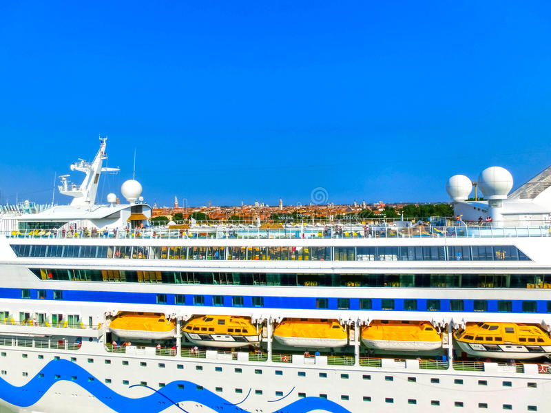 Venice, Italy - June 06, 2015: Cruise liner AIDA Vita docked at the port. Of Venice, Italy on a background of the roofs on June 06, 2015 stock images