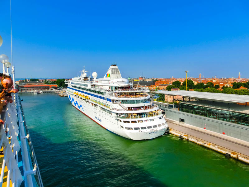 Venice, Italy - June 06, 2015: Cruise liner AIDA Vita docked at the port. Of Venice, Italy on a background of the roofs and another cruise ship on June 06, 2015 royalty free stock image