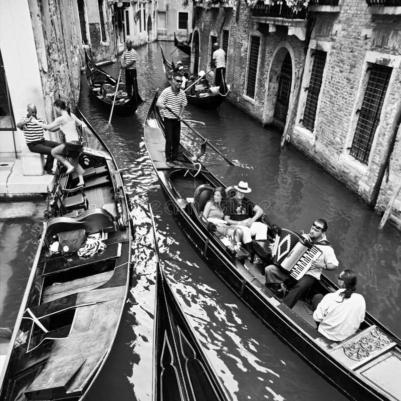 Venice, Italy - June 30, 2009: Life in Venice, travelling by gondolas with gondoliers, black and white photo. royalty free stock photography