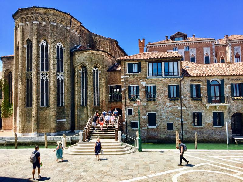 Tourists walking outside the Peggy Guggenheim Museum in the heart of Venice, Italy on a beautiful summer day. royalty free stock photos