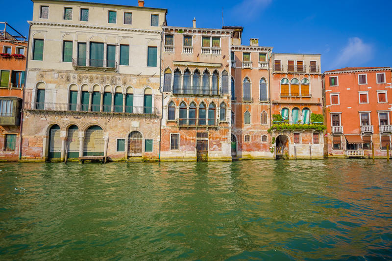 VENICE, ITALY - JUNE 18, 2015: Traditional houses in Venice, it seems floating in the water. Nice day royalty free stock photography