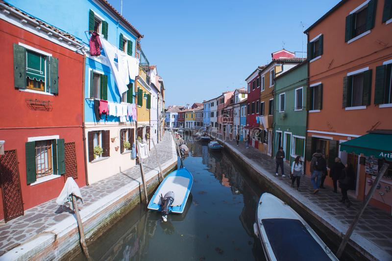 Venice, Italy, march 2, 2019. Burano Canal. Yellow, venezia, old, beautiful, street, italia, island, house, city, famous, paint, river, boat, tourism, murano royalty free stock photography