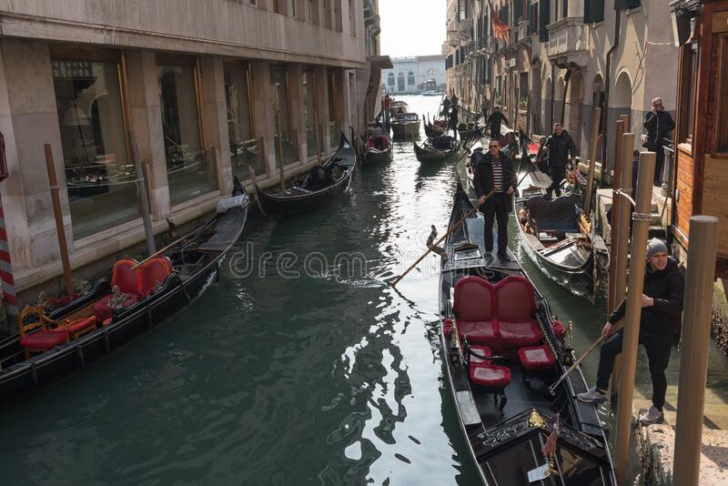 Venice, Italy - March 1, 2019: Gondolas on a canal in the streets of Venice stock photo