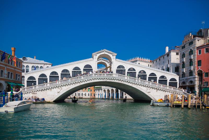 VENICE, ITALY - March 24, 2019: Venice Grand canal with gondolas and Rialto Bridge, Italy in spring bright day stock image