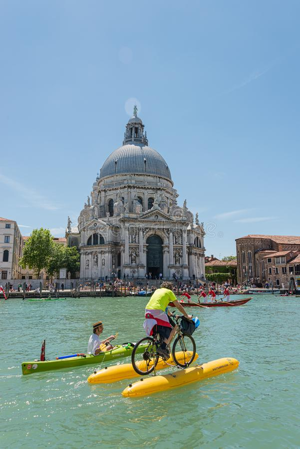 Venice, Italy - May 24, 2015: Annual Vogalonga Regatta, funny rowing racing in the Venetian Grand Canal around historical stock photo