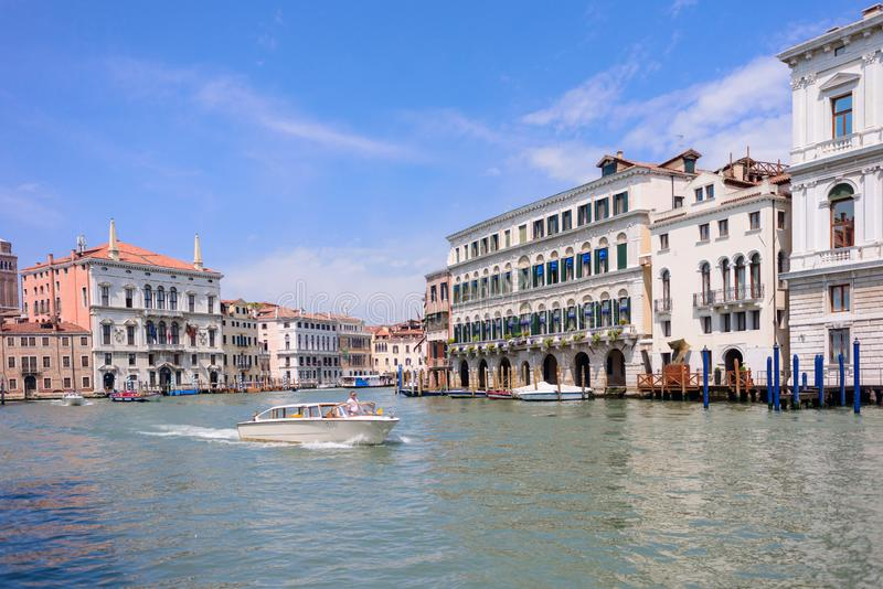 VENICE, ITALY - MAY, 2017: Beautiful view to colorful Venetian architecture located near Ponte di Rialto/ Rialto bridge, water. Tram stop/station at the Canal royalty free stock photos