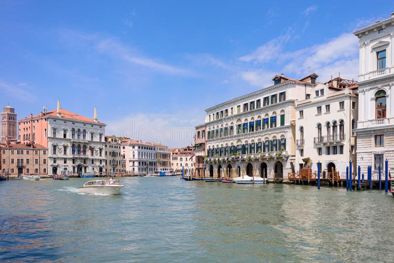 VENICE, ITALY - MAY, 2017: Beautiful view to colorful Venetian architecture located near Ponte di Rialto/ Rialto bridge, water. Tram stop/station at the Canal stock photos