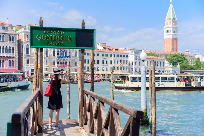 VENICE, ITALY - MAY, 2017: girl tourist standing on the pier in the background of the panorama of Venice stock images