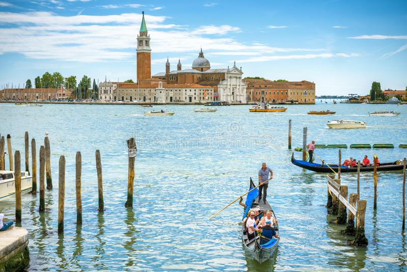 Gondolas with tourists in Venice, Italy royalty free stock image