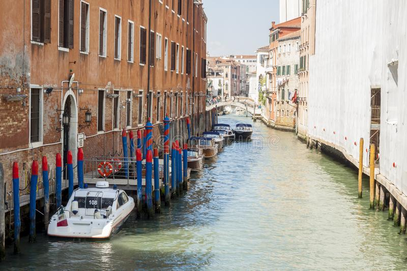 Narrow canal in old town of Venice - Italy stock images