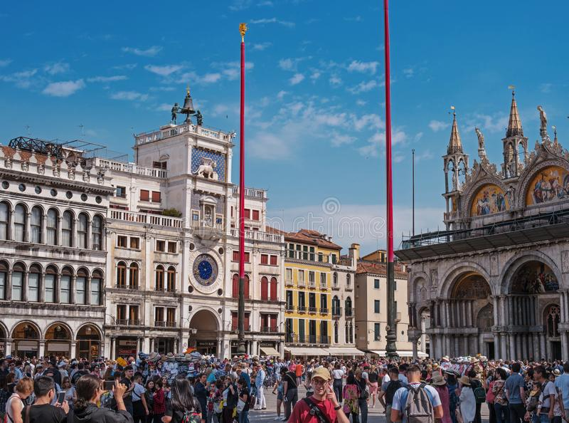Venice, Italy - 08 May 2018: Panorama of the Piazza San Marco. Many tourists on the square. Left clock tower, on the royalty free stock image