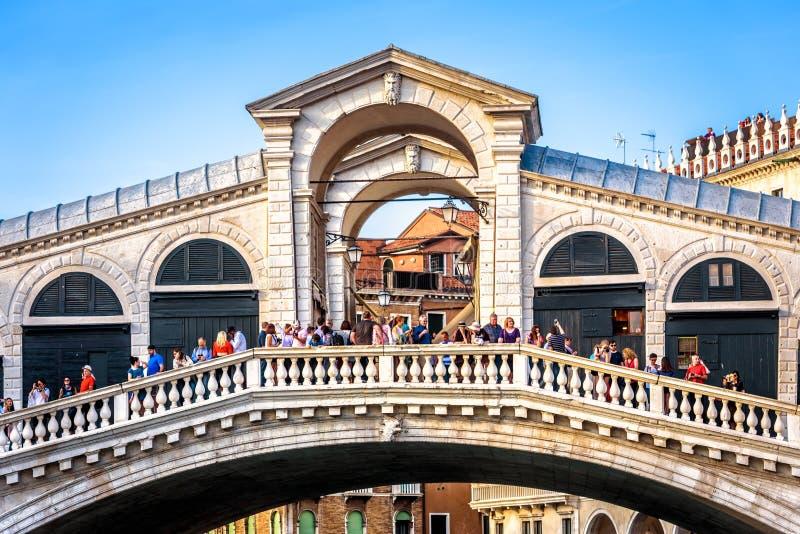 Rialto Bridge with many people in Venice stock photos