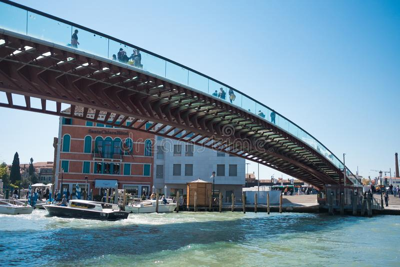 Venice, Italy - 10 may 2019: view from below of calatrava bridge  during sunny summer day with people walking on it and boats. View from below of calatrava stock photo