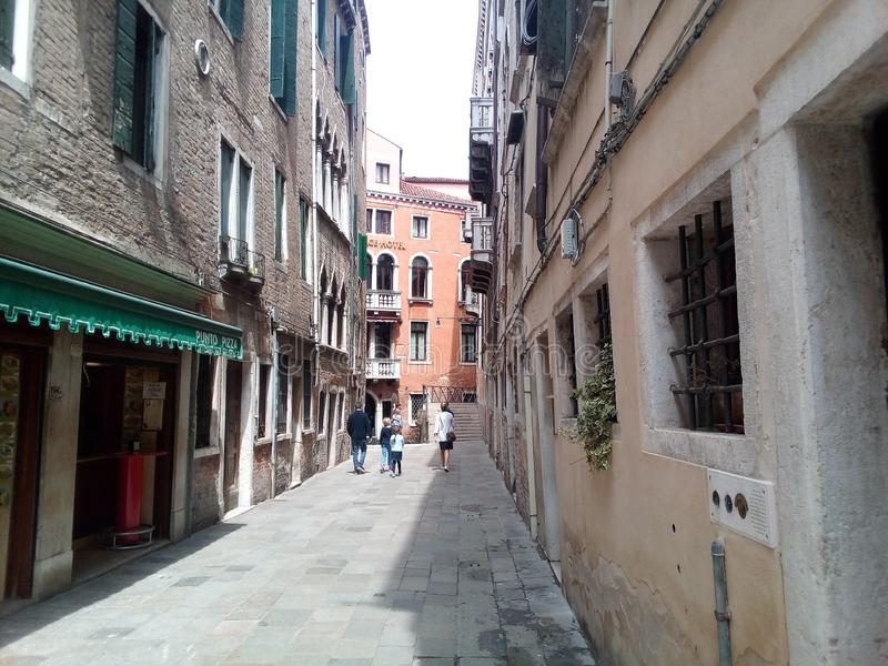 Venice, Italy, narrow medieval streets. Pedestrian part of the city. royalty free stock images