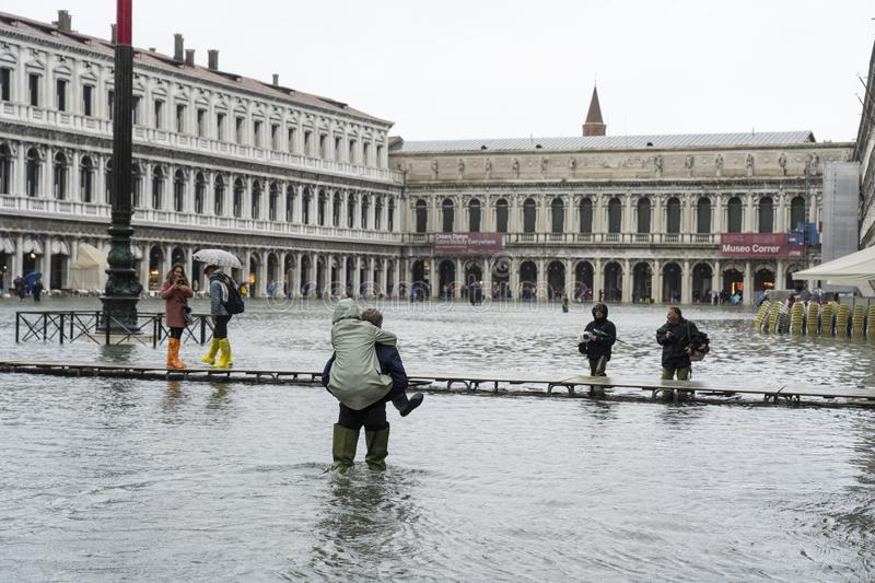 VENICE, ITALY - November 12, 2019: St. Marks Square Piazza San Marco during flood acqua alta in Venice, Italy. Venice high stock image