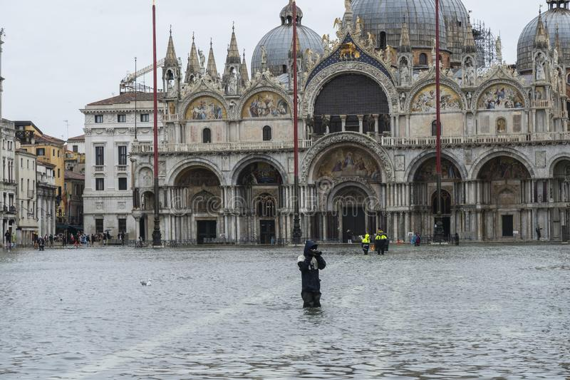 VENICE, ITALY - November 12, 2019: St. Marks Square Piazza San Marco during flood acqua alta in Venice, Italy. Venice high royalty free stock images