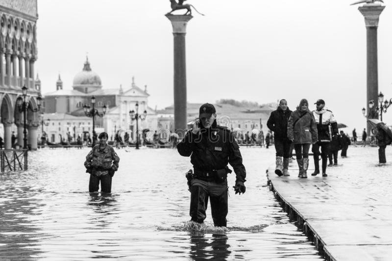 VENICE, ITALY - November 12, 2019: St. Marks Square Piazza San Marco during flood acqua alta in Venice, Italy. Venice high stock photo