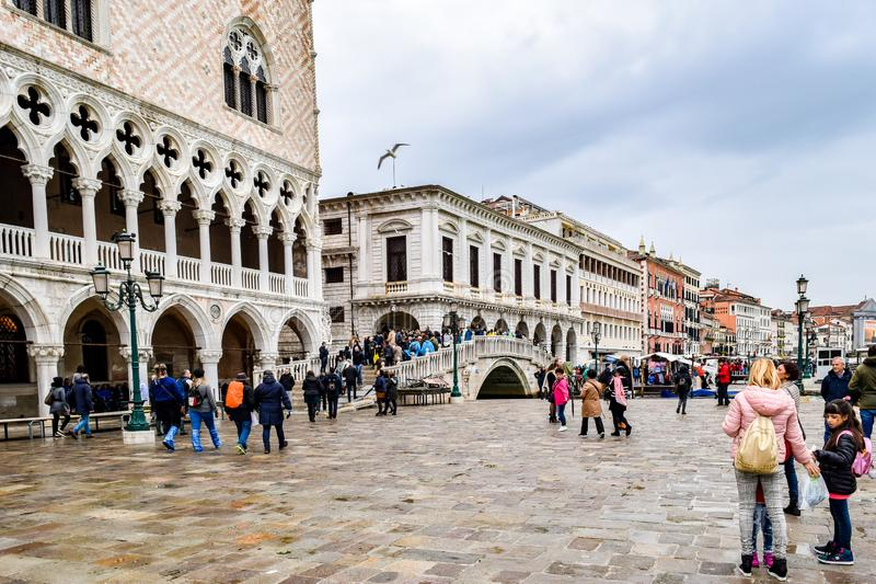 Tourists on a rainy day in Piazza San Marco St Marks Square in Venice, Italy. Venice, Italy - November 2, 2018: Tourists on a rainy day in Piazza San Marco St stock photography
