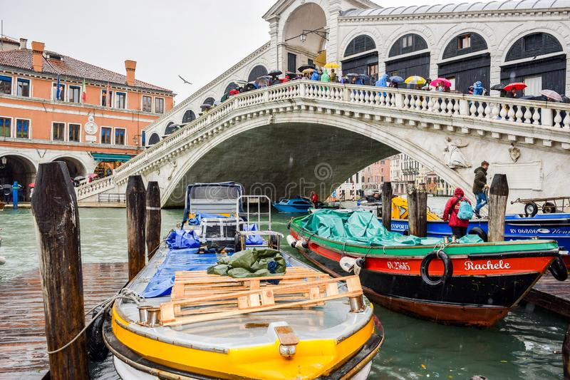 Tourists on a rainy day at Rialto Bridge on the Grand Canal in Venice, Italy. royalty free stock photo