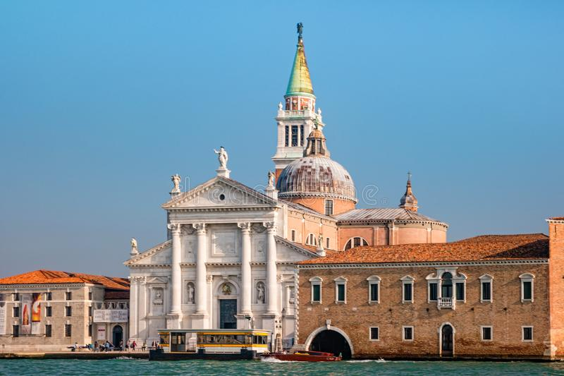Bell tower and church of Saint George also called San Giorgio Maggiore in Venice, Italy stock photo