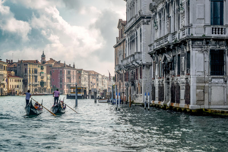 VENICE/ITALY - OCTOBER 12 : Gondoliers Ferrying People in Venice. Italy on October 12, 2014. Unidentified people royalty free stock photo
