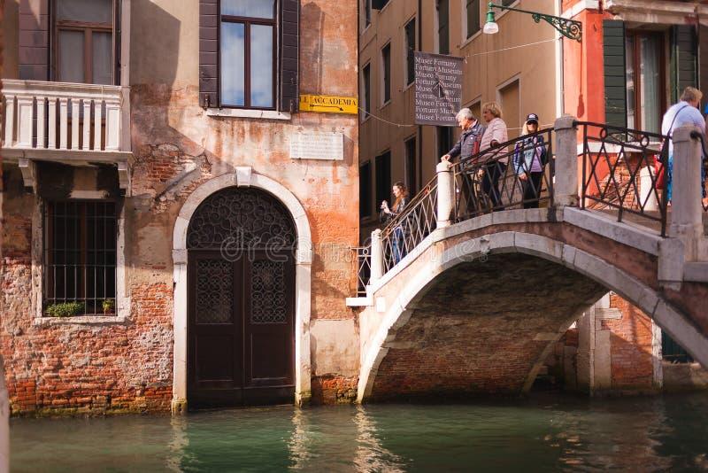 VENICE, ITALY - OCTOBER, 08 2017: Tourists on ponte de la Cortesia, Venice, Italy. VENICE, ITALY - OCTOBER, 08 2017: Tourists on little old bridge ponte de la royalty free stock photography
