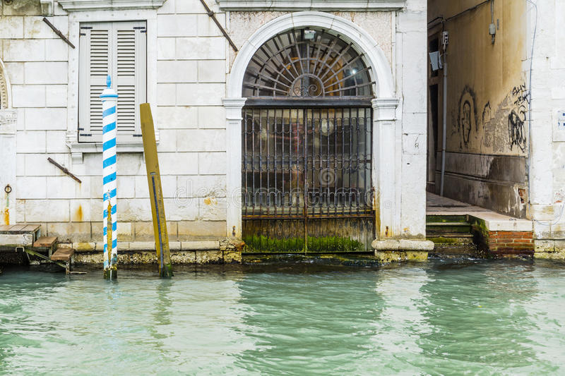 Venice in Italy. One of the many side streets and Gate to the building in Venice without tourists , Italy . Europe. And small canal. View from the publick royalty free stock photos