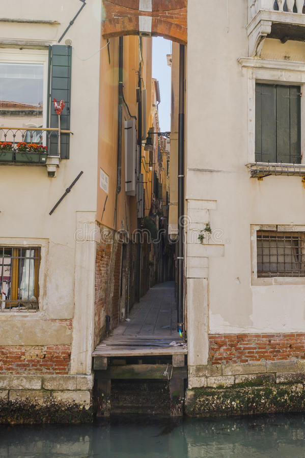 Venice in Italy. One of the many side streets in Venice without tourists , Italy . Europe. And small canal royalty free stock photography