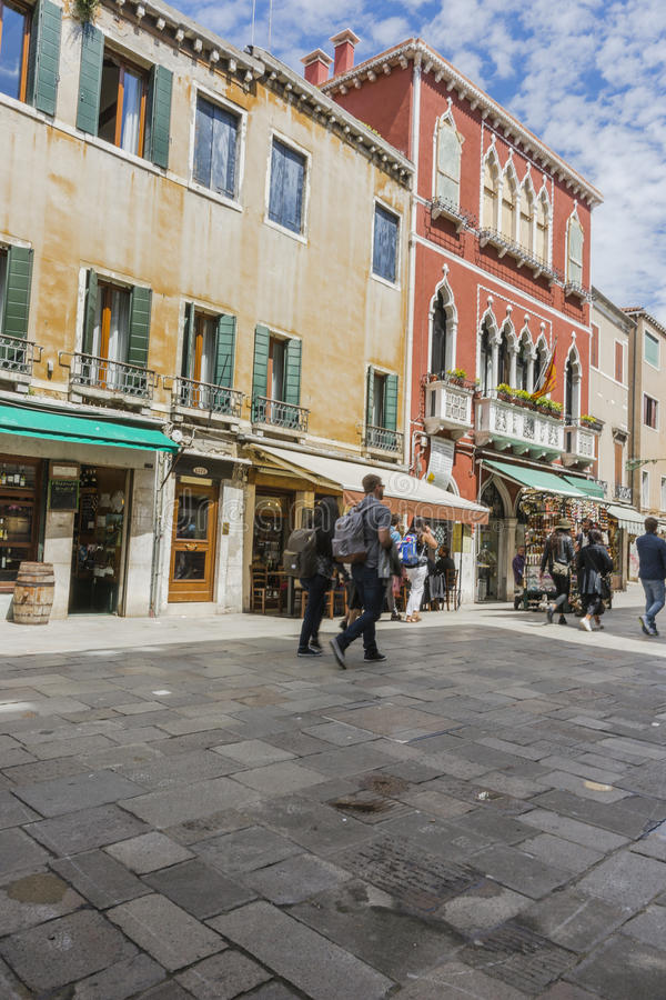 Venice in Italy. One of the many streets with tourists and shops in Venice , Italy. Europe royalty free stock photo